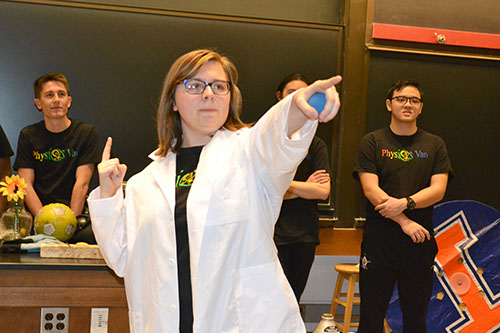 Physics Van coordinator Spencer Hulsey interacts with the Chicago students during one of her group's demos.
