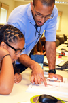 GLEE camp director, Lynford Goddard, instructs a camper during a session on optics.