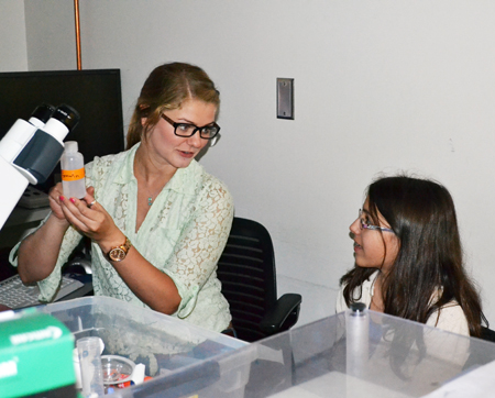 Grad student interacts with a Pollen Power camper during one of the sessions.