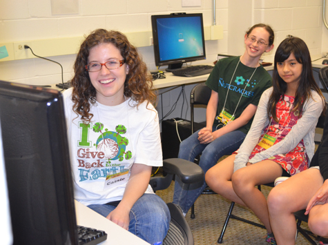 Cassie Wesseln, left, and some campers enjoy graphics created with special imaging software