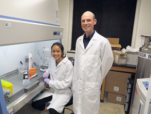 ResearcHStart participant Joy Chen with Professor Erik Nelson in his lab at Beckman (photo courtesy of Ashley Lawrence).